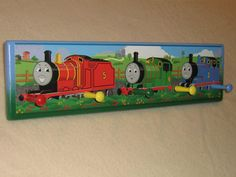 Hey, I found this really awesome Etsy listing at http://www.etsy.com/listing/95584185/kids-corner-coat-rack-thomas-the-train