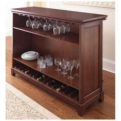 Features:  -Martinez collection.  -Stemware and bottle storage.  -Front foot rest.  -Hardwood solids and veneers.  -Foot Rails: Yes.  -Back Shelves: Yes.  Product Type: -Home bar.  Style: -Traditional