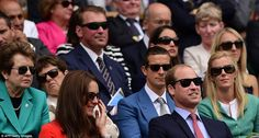 Getting stuck in: The couple wore sunglasses as they watched the action from the royal box...