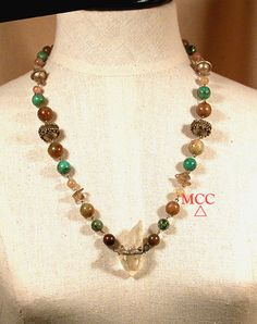 """We've dreamed up our Turq necklace and know you'll want to start wearing it right away!  26"""", it's of sterling silver, gunmetal silver findings and beads with granulation linking taupe antique soochow jade, nearly clear red jade, African turquoise, and smoky quartz with a RARE natural pale smoky quartz Arkansas rainbowed crystal.  Enjoy!"""