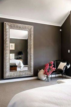 Stunning mirror and colour scheme | brown bedroom | large mirror in bedroom