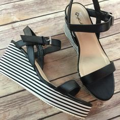 Black & White Stripe Wedge Sandals New just tried on and wandered through the house once. Didn't end up wearing them out. 1 inch platform and a 3 inch heels. Qupid Shoes Sandals
