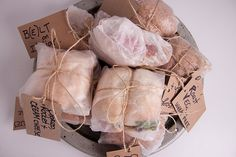Picnic parcels, full of organic food, including homemade sandwiches packaged in…