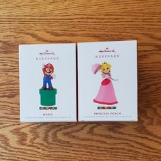 SELLING: Brand new in box Hallmark Keepsake Super Mario and Princess Peach holiday Christmas tree ornament set. Characters featured from the Super Mario video game series. Mario is going into a green pipe and Peach is holding an umbrella. Wonderful collector's set! All items come from a smoke-free and pet-free home. Hallmark Christmas, Christmas Holidays, Mario Video Game, Mario And Princess Peach, Hallmark Homes, Super Mario, Christmas Tree Ornaments, Seasonal Decor, Smoke Free