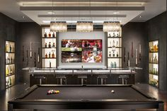Great Home Bar with Theater like screen viewing from bar stools.