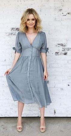 With a sweet vintage appeal, this midi dress has a. With a sweet vintage appeal, this midi dress has a button down V neckline and empire waist. It is accented with cuffed tie sleeves and pockets. Midi Dress Outfit, Flowy Midi Dress, Satin Midi Dress, Dress Skirt, Dress Outfits, Fashion Dresses, Midi Dresses, Dress Prom, Dress Wedding