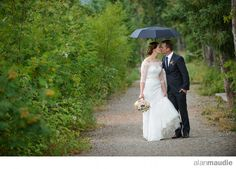 Golden B.C. Wedding, Bride and Groom under umbrella, Kicking Horse Mountain Resort Wedding Photographer