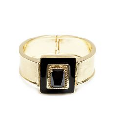 The alluring Linette bangle is a sexy, sophisticated vision in black and gold. With square onyx as its centerpiece, Linette manages to be both striking and understated. This evening-ready piece is perfect for your next party.  Find it on Splendor Designs