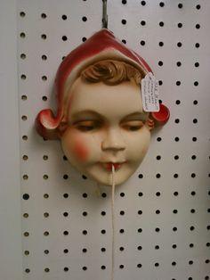 Vintage chalkware string holder.