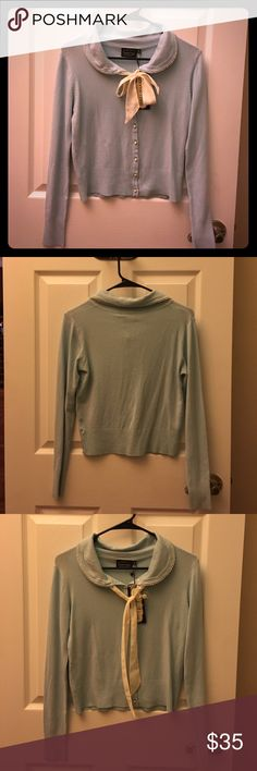 Fancy baby blue pearl sweater Never worn with original tag still attached. Size small blue button up sweater. Faux pearls are used as the buttons as well as the lining around the collar with white ribbon to tie into a bow. Voodoo Vixen Sweaters Cardigans