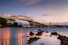 Auckland Harbour Bridge from Little Shoal Bay — Geoff Billing Photography Harbor Bridge, Sydney Harbour Bridge, New Zealand Holidays, Sunset Photography, Photography Ideas, New Zealand Houses, Auckland New Zealand, Beautiful Places, Vacation