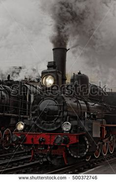 Old steam locomotive. Low key photo. Vintage style.