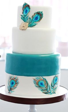 White and teal peacock feather wedding cake