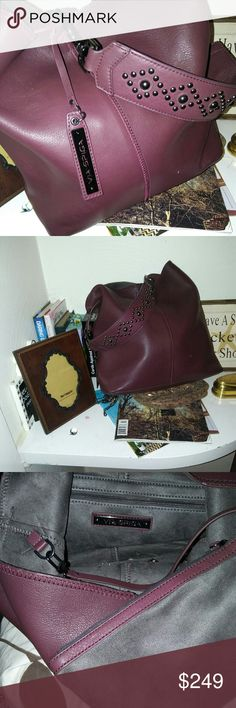 """NWT Slouchy Butter Soft Leather from VIA SPIGA The camera doesn't do justice to this supple deep maroon spacey, trendy, sexy bag! One zipper pocket inside, but also comes with a handy make up bag attached by a leather strap. The make up bag is the same grey color as the inside of the purse. There's also an outside boasts a large magnetic closure, as is the bag. Shoulder strap is removable, but looks fabulous with patterned studs! Strap drop is 11"""" Beautiful, Perfect. Pure Class Via Spiga…"""