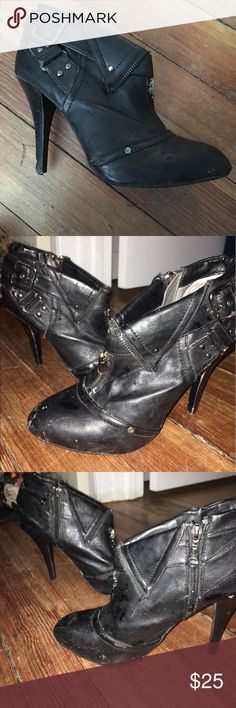 cute booties G by Guess high heel booties. Cute zippers and straps on the side and top. Scuffs are shown in pictures. The flash was on so you could see them...but not very noticeable in person G by Guess Shoes Ankle Boots & Booties