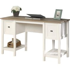 Pen thank you notes in the study or arrange a vignette of framed photos in the parlor with this lovely writing desk, featuring 2 drawers and white finish....