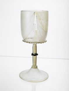 Goblet This fine wineglass, decorated with trail of blue glass around the stem, was probably made in Italy or southern France. It was found during excavations on the site of Winchester Palace, on Bankside, Southwark, the great London home of the Bishop of Winchester.  Production Date: Late Medieval; 14th century