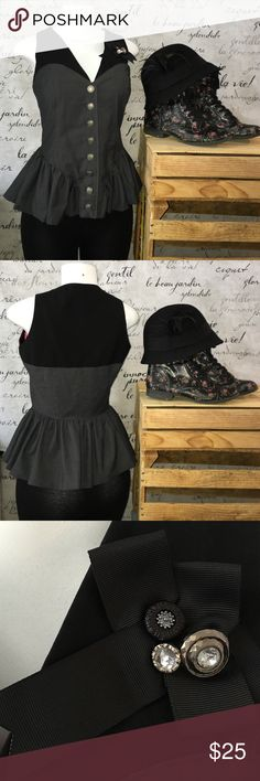 Goth-sexy Peplum black vest/shirt Goth-sexy peplum vest/shirt. Tag says medium but fits like a small. This has a versatile quality to it. In like new, great shape! I am open to reasonable offers and offer a bundle discount! Let me know how I can help you to get this piece into your personal closet! Twelve by Twelve Tops Button Down Shirts