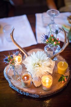 Antler wood slice centerpieces with full bloom dahlia | Private Mountain Wedding Nestled Lakeside Along The Sierra Nevada Mountains | Photograph by Kiel Rucker Photography   http://storyboardwedding.com/private-mountain-wedding-lake-sierra-nevada-mountains/