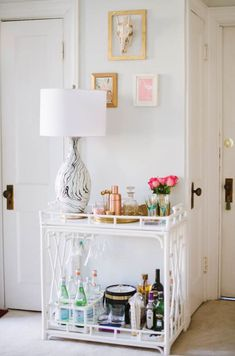 & is a beautiful bar design that is inexpensive, simple to create and will improve the home decor and brighten up a small space in your home. What would you add to improve your own bar? Bar Cart Styling, Bar Cart Decor, Mini Bars, Style At Home, Gold Bar Cart, Table Bar, White Bar, Bar Furniture, My Living Room