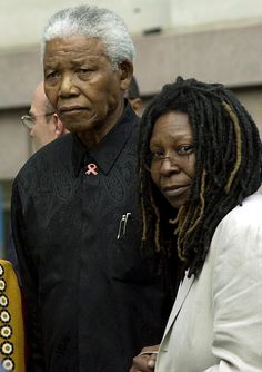 Nelson Mandela stands with Whoopi Goldberg at the opening day ceremony of the 2002 Tribeca Film festival in New York