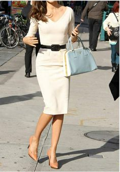 Classic and chic white dress made perfect by the skinny black belt and nude pumps