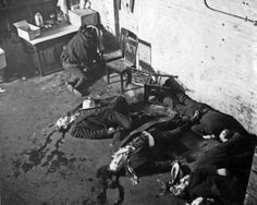 St. Valentine's Day Massacre,1929 Chicago. A group of men disguised as police officers lined up 7 men against the wall and shot them to death. The 7 men were mob associates. It is unclear who was responsible for the deaths, but police suspected either Al Capone of the South Side Italian gang or his rival Bugs Moran of the North Side Irish gang was responsible. The massacre completely tarnished Al Capone's reputation.