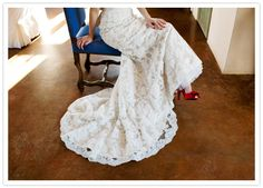 cascading lace train and vibrant red heels