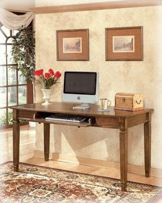 "Traditional Medium Brown Hamlyn Home Office Large Desk by Famous Brand Furniture. $419.13. 60"" W x 27.88"" D x 30.13"" H. Made with select hardwoods and cherry veneer with Prima Vera inlay veneer. Rich medium brown finish. Antique bronze color metal hardware. Pull down keyboard tray. With rich traditional style infused with a European flair, the sophisticated elegance of the ""Hamlyn"" home office collection is sure to enhance the beauty of any home office decor. The rich m..."