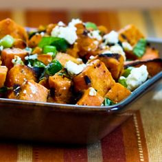 Grilled Sweet Potato Salad with Green Onion, Basil, Thyme, and Feta. Makes about 4-6 servings  2 large orange-fleshed sweet potatoes, about 2 lbs. total (orange-fleshed sweet potatoes may be called yams in some stores) 1/4 C + 1/4 C purchased vinaigrette dressing (I used Newman's Own Olive Oil and Vinegar Dressing, use dressing with less than 3 grams of sugar per serving for South Beach Diet) salt and fresh ground black pepper to taste 1/2 cup thinly sliced green onions 2-3 T thin…