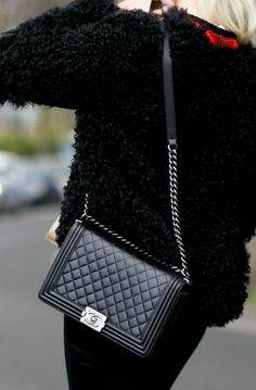 Chanel bags alway steal the street style spotlight. Click to see more. | Via IMAXTREE