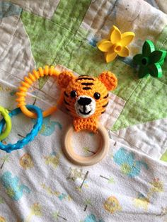 This cute tiger is free on Cute and Cozy Crochet.com Please check yourself if it's suitable for babies.