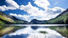 Bright skies reflect off of Buttermere Lake in Cumbria (Credit: Credit: JPagetRMphotos/Alamy)