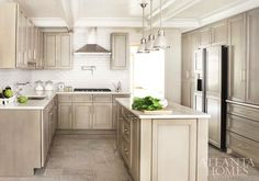 Atlanta Homes & Lifestyles: Beautiful u-shaped kitchen with gray washed ash cabinets and natural stone tile floors. ...
