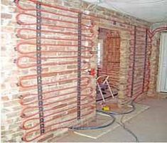 Wall heating can be combined with clay. Radiation heat is felt by the human being as soothing, since it comes close to the natural conditions. Hydronic Radiant Floor Heating, In Floor Heating, Cavity Wall Insulation, Cordwood Homes, Heat Pump System, Radiant Heat, Underfloor Heating, Modern House Plans, Heating Systems