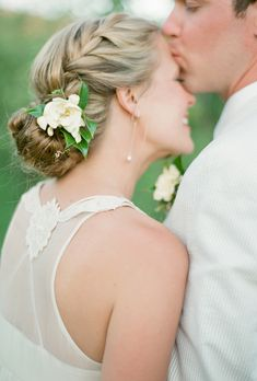 This low bun, complete with a classic French braid, screams garden wedding. Complement the simple look with a pale-hued flower or sparkling accessory. See more summer wedding hairstyles.