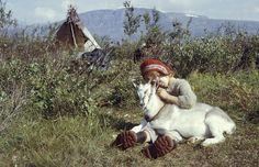 Girl and goat at a Sami camp by lake Satisjaure (Satihaure) in Lapland, 1958