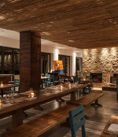 In the hotel's restaurant, a communal pinewood table built by local craftsman is designed to spur creative collaboration, with turquoise chairs adding a fun and beachy pop of color. San Jose Del Cabo, Brewery Design, Restaurant Design, Restaurant Ideas, Turquoise Chair, Seaside Art, Wood Columns, Rustic Luxe, Cottage Renovation