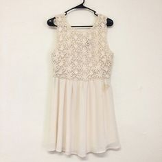 Floral Lace Cream V Neck Dress This absolutely gorgeous, lace, v neck dress by Forever 21 is perfect for both dressing up for a part and dressing more casually for work! It does have a brown stain on it as pictures. It is a size medium. Check it out! Forever 21 Dresses Mini
