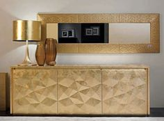 This Fendi credenza with gold lamp and mirror is breathtaking