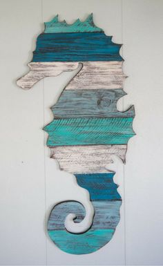 Ahhhh I want to go to the beach! This seahorse is perfect for a beach house or for folks like me that just always want to be at the beach (but don't live there!). Seahorse Pallet Wood Wall Art, Beach house wall decor, Coastal wall art, Nursery decor, Rustic sign, beach home decor, Rustic beach decor #ad