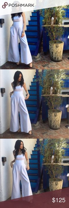 Kendall & Kylie Jumpsuit Chic white jumpsuit with front cut out and wide leg. Simple yet makes a bold statement. Kendall & Kylie Dresses