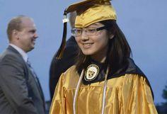 Lillian DeDomenic   For The Tribune-Review Helen Yang receives her diploma during Gateway High School commencement exercises held in Antimarino Stadium on Thursday evening, June 2, 2016.