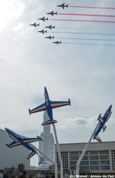 Fly past of the Patrouille de France Dassault Alphajets, over the Musée de l'Air et Espace, at Le Bourget, on the ocassion of the reinauguration of the entrance hall, restored to it's original appearance in 1937 (when it was a major airport). Also redisplayed after restauration the 3 Fouga Magisters (foreground), trainer/ground attack/COIN aircraft,  former mounts of the Patrouille for many years.