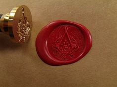 I just got my custom-made wax seal bought on shopping site. AC logo from Revelations. Looks like Yusuf used it for sealing letters to . Ac Logo, Assassins Creed Logo, Fandoms, Wax Seals, Geek Stuff, Assassin's Creed, Survival, Cool Stuff, Chaos Rings