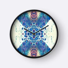 This clock features a print of my digitally manipulated original fluid acrylic painting. The painting has been professionally photographed, digitally manipulated by me, and will be professionally printed for you on a beautiful clock. Features:  Sizing Information Diameter: 10.25 Depth: 2  -Modern printed polypropylene face without plexiglass -Bamboo wood frame with natural finish or painted black or white -4 metal hand colours to choose from -Quartz clock mechanism (AA battery not included)…