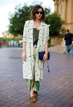 Marni coat The Row top Dries Van Noten pants Prada clutch