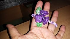 This rainbow loom bracelet was made by adapting a design by Justin's Toys. The flower is a hexafish, and the leaf is based on the hibiscus design.