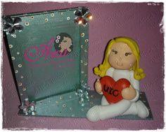 Porta retrato pequeno com biscuit Enfermeira com coração de biscuit R$ 30,00
