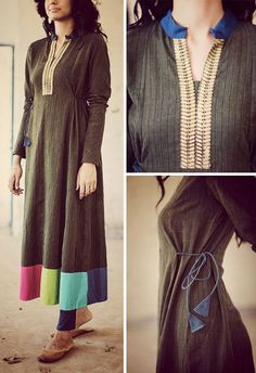 The earthy olive floor length anarkali with contrast bands at hem can be worn as a dress if you please. There are princess to princess tie-cords for a better fit. The neck is a deep V neck with embroidered gold lace running along. The band collar as neck has a hint of hand block printed fabric in blue.